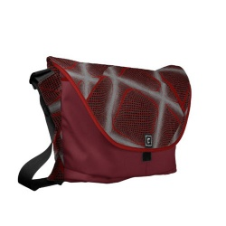 dark red and black geometric swirl messenger bag left view