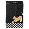 Arching tabby cat on black towel with checkered border