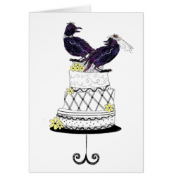 bride and groom crows on top of wedding cake